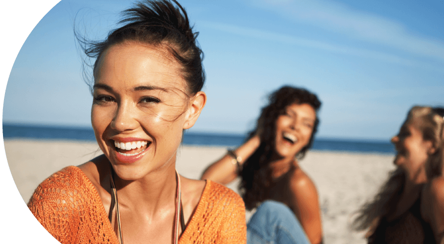women smiling on beach